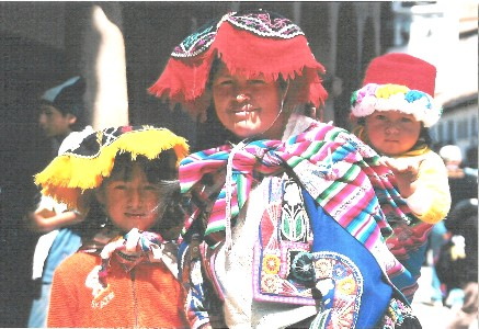 The people of Peru still wear their native dress, whether marketing in town or working the fields.  Their type of hat denotes what region they are from.